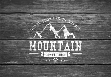 Mountain Logo on Wooden Background